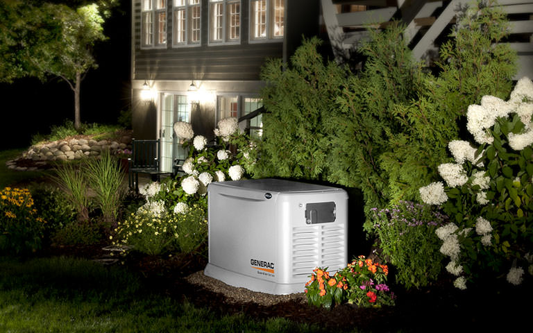 generac guardian automatic generator at night